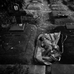 PRASS_PRASETIO_Little_Girl_Naps_Among_the_Graves